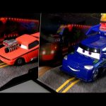 2013 Cars Snot Rod & DJ Disney Collector Acrylic Display Case w/ Mack truck background card
