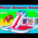 BOUNCE HOUSE Surprise Worlds Largest Water Bounce House Paw Patrol + Lion Guard Toys Video