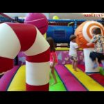 Indoor playground for kids. Inflatable lollipops, balls, slides and funny toys for playing