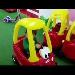 Indoor playground for kids. They drive little toys cars and slide in balls.