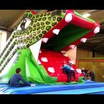 Indoor playground for kids with inflatable slide crocodile . Funny video.