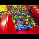 Indoor playground fun for kids. Video with children who  playing with balls.