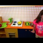 Kids  cooking food in a  kitchen toy set. They love to  playing.  Special for girls