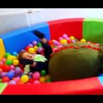 Kids fail an indoor playground  and playing with toys, ( balls, castle, train, cars )