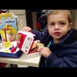 Kids meal time at McDonalds. Video with toys surprise. Family fun.