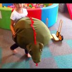 Kids  playing with toys an indoor playground. Fun in pool balls,  slides, and more