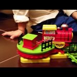 Toy train for children. Funny video with surprise gift for birthday