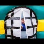 Outdoor playground fun for kids with bouncy castle. Video 2016