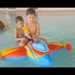 Fun with kids at water park.  Unboxing inflatable toy plane. Video 2016