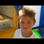 Water park fun. Kids playing in water on octopus slide .Family Video 2016