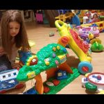 Kids playing in indoor  playground. Family Fun for kids. Cars, sliders and more toys