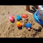 Kids playing on the beach. Challenge of catching toys. Funny video