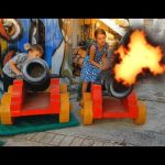 Playground for kids. Fun with inflatable toys and guns. Video 2017